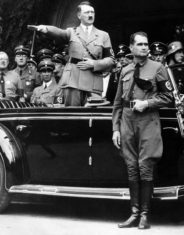 This Dec. 30, 1938, photo shows German Chancellor Adolf Hitler and his personal representative Rudolf Hess, right, during a parade in Berlin.