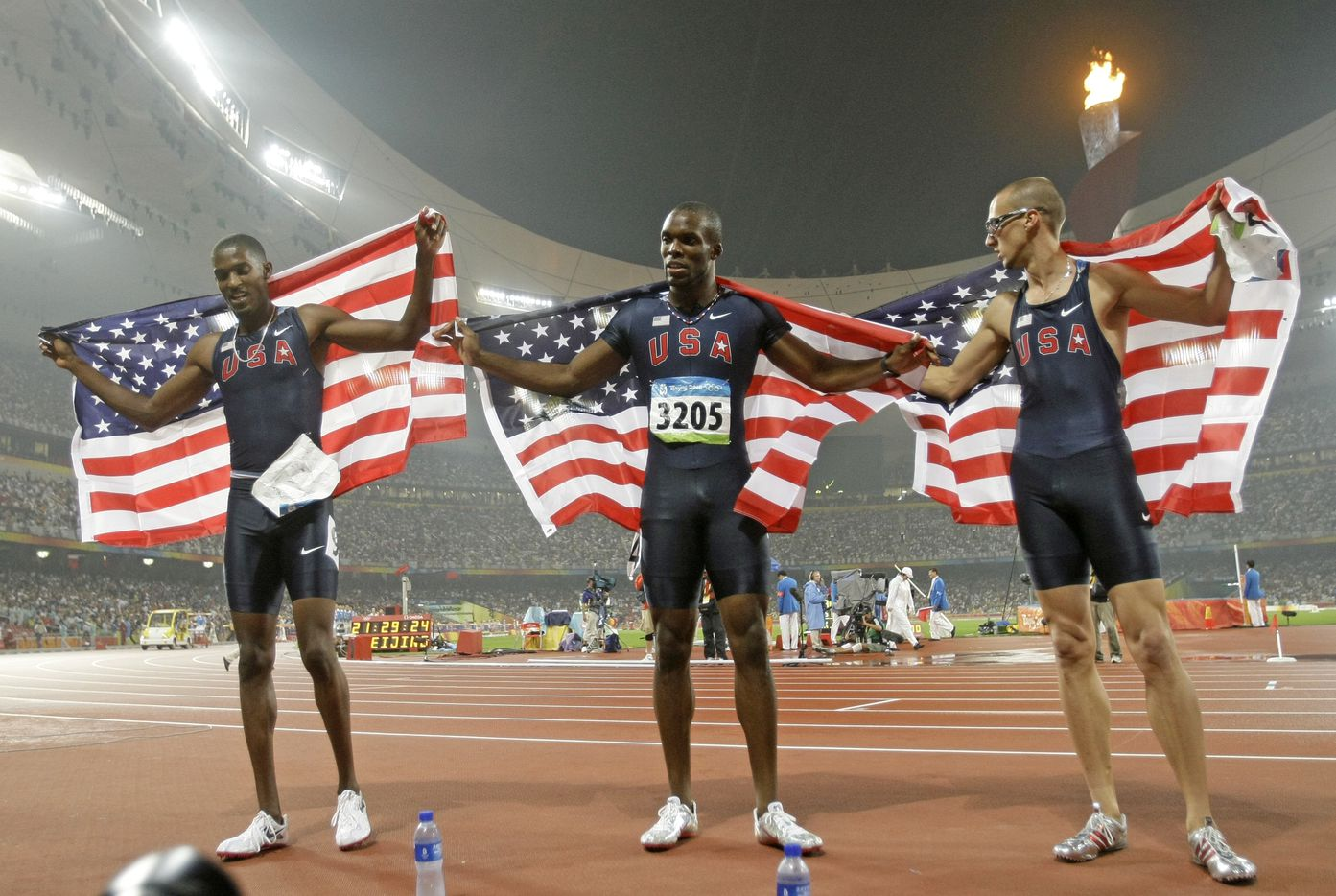 2008 Beijing Olympics: USA runners sweep the Men's 400 meters at the National Stadium  in Beijing, China Thursday August 21, 2008. From left, David Neville (bronze), LaShawn Merritt (gold), and Jeremy Wariner (silver).
