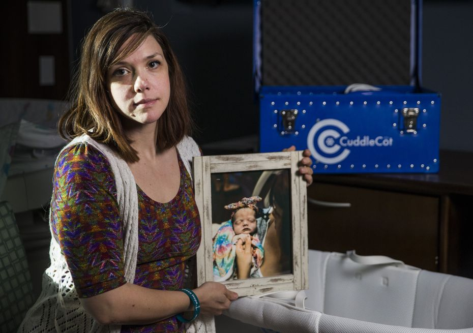 Chelsea Schwartz holds a photo of her stillborn daughter, Talia Joy, next to a bassinet and CuddleCot on Thursday, December 19, at Medical Center Frisco. Schwartz led a fundraising campaign to buy a CuddleCot, a device that preserves babies lost at birth for up to several days, for the hospital to give grieving parents extra time with their babies.