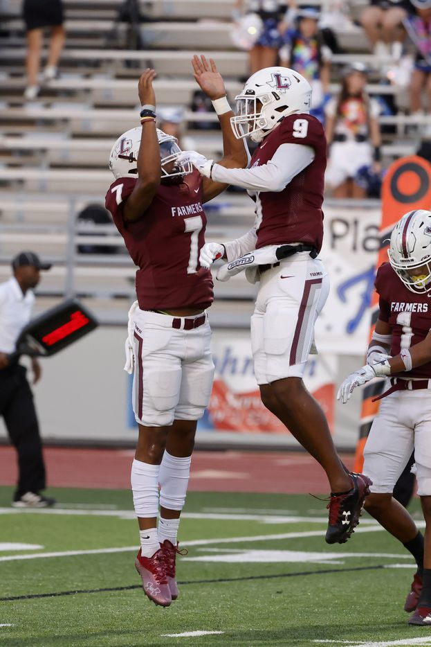 Lewisville quarterback Ethan Terrell (7) congratulates  Armani Winfield (9) after they connected on a touchdown pass against Plano West during the first half of a high school football game in Lewisville, Texas on Friday, Sept. 24, 2021. (Michael Ainsworth/Special Contributor)