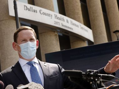 Dallas County Judge Clay Jenkins addresses the media about the current state of the coronavirus Delta variant outside the Dallas County Health and Human Services building in Dallas, Tuesday, August 10, 2021. He also spoke about the differences between he and Texas Governor Greg Abbott when it comes to a mask mandate. (Tom Fox/The Dallas Morning News)