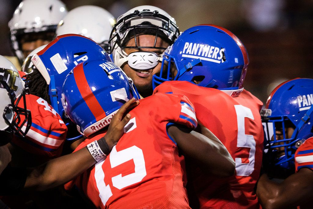 South Oak Cliff quarterback Rodney Hudson (6) is wrapped up by Duncanville defenders Tyler Quinn (42), James Roberts, Jr. (15) and Christopher Thompson (5)  during the first half of a high school football game on Friday, Sept. 6, 2019, in Duncanville.