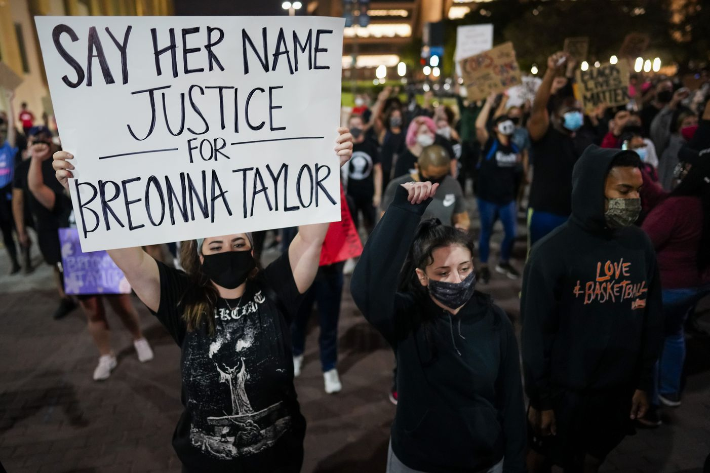 Demonstrators march on Ervay Street near Dallas City Hall after a Kentucky grand jury brought no charges against Louisville police for the killing of Breonna Taylor on Wednesday, Sept. 23, 2020.