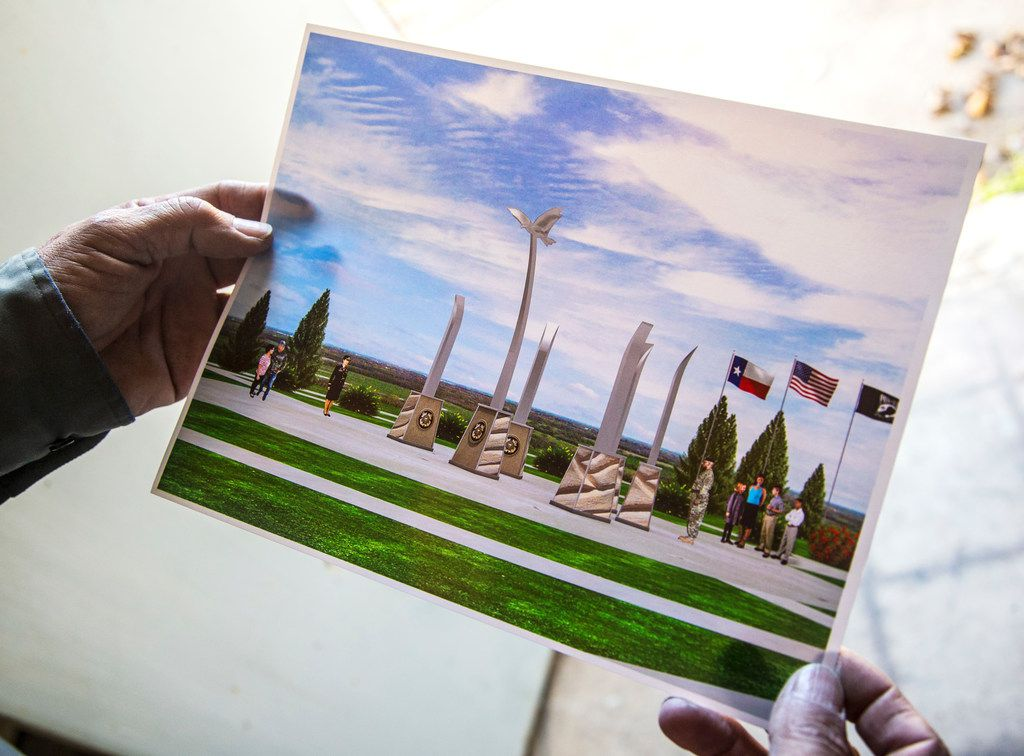Sculptor Eliseo Garcia holds a photo illustration of the future memorial plaza near the banks of the Trinity River on Nov. 15, 2018. Garcia was selected for a $75,000 city-funded commission to design the sculpture.
