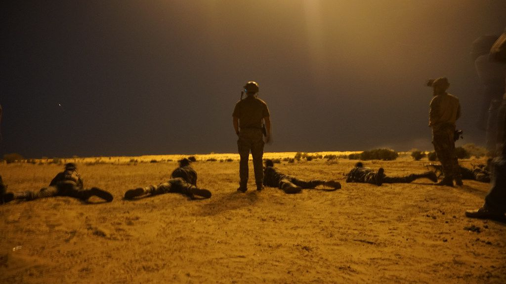 In this photo released by the US Army on March 9, 2017, US Army Special Forces soldiers observe as Nigerien armed forces service members fire their weapons with the assistance of illumination rounds during Exercise Flintlock 2017 in Diffa, Niger.  Four US soldiers and one from another nation were killed when a joint US-Niger patrol was ambushed near the border with Mali in southwest Niger, the Pentagon confirmed on October, 6, 2017.