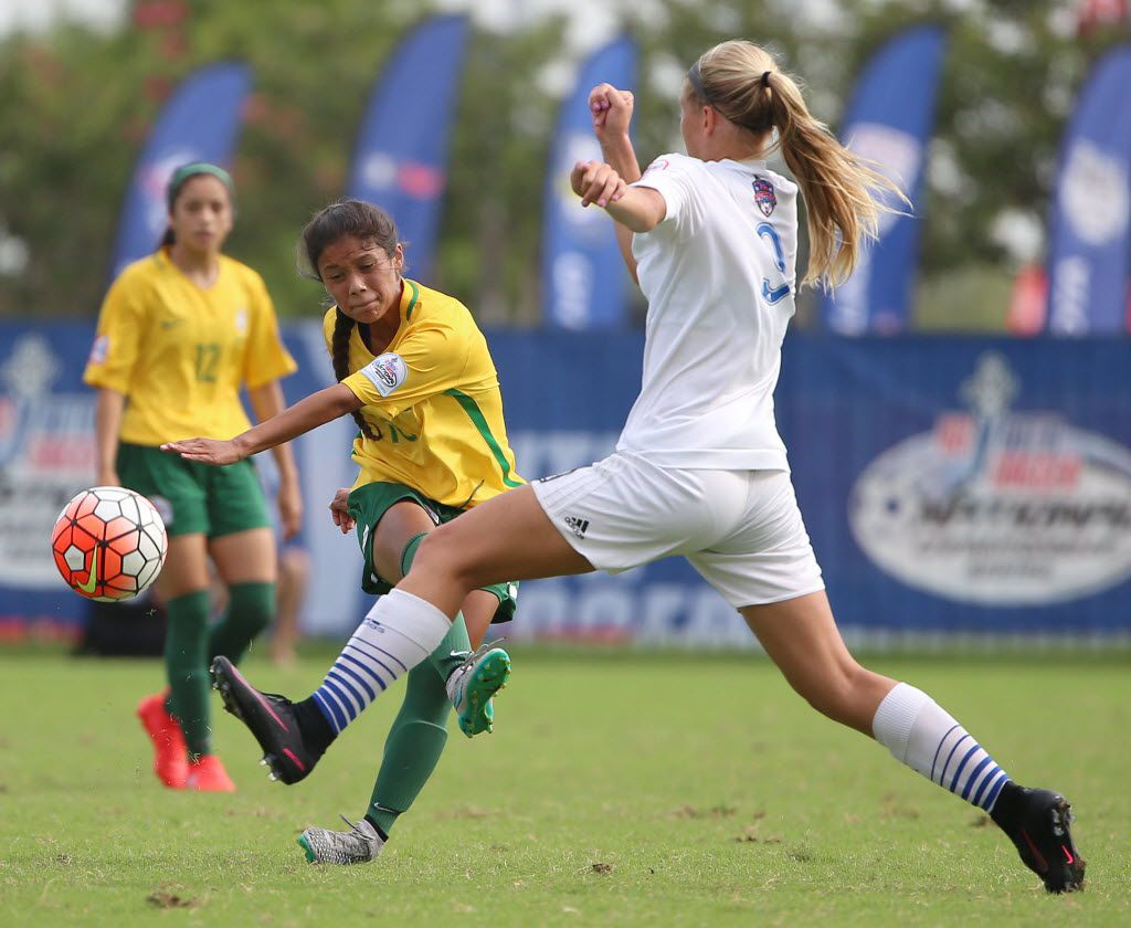 Dallas Kicks player Samantha Meza (left) kicks the ball by Midwest United player Bria Schrotenboer in the first half during a third round match in group play between the Midwest United FC 01 Royal and Dallas Kicks SC 01 at the U.S. Youth Soccer National Championships at the Toyota Soccer Center in Frisco, Texas Thursday July 28, 2016. Midwest United beat Dallas Kicks 1-0. (Andy Jacobsohn/The Dallas Morning News)