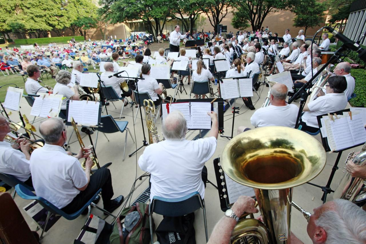 File photo of the Richardson Community Band performing their Dog Days of Summer concert Sunday outside of the Richardson Civic Center in 2019.