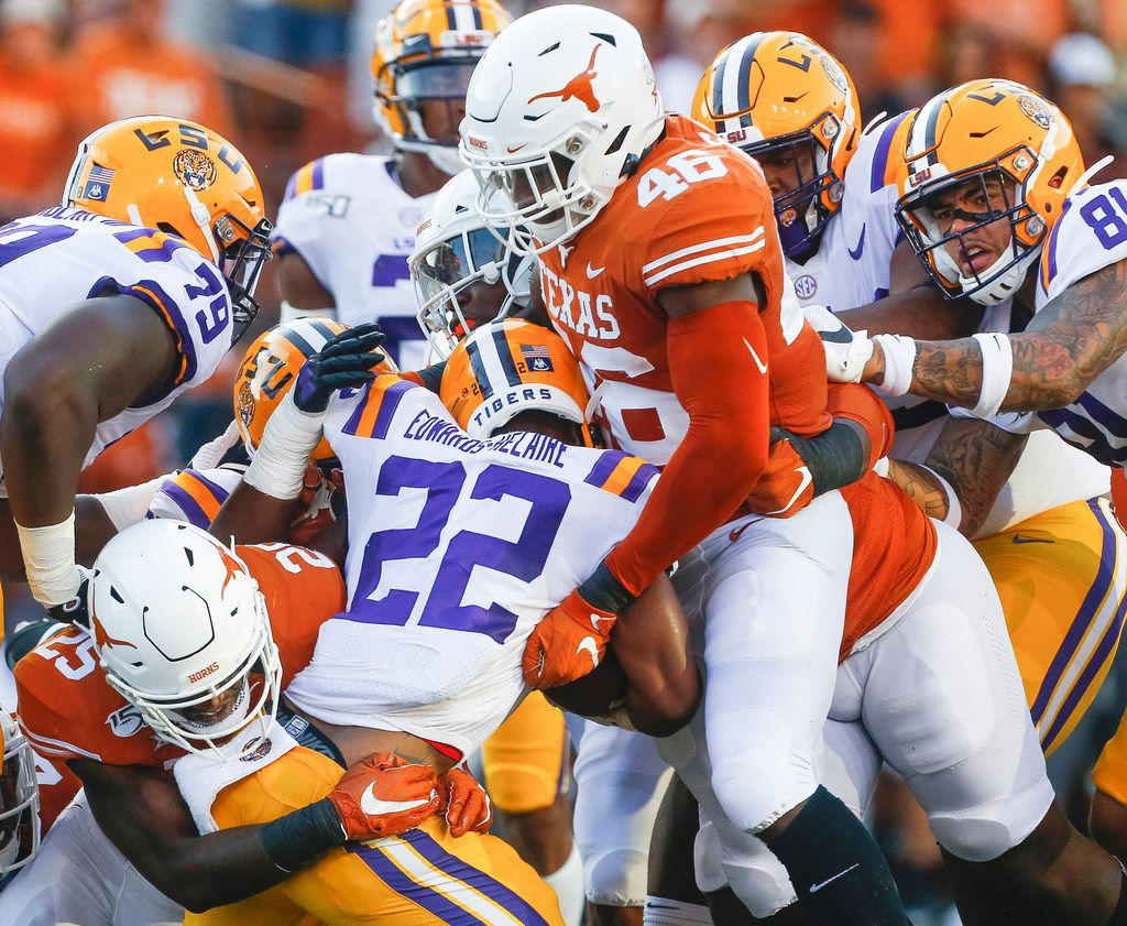 Texas Longhorns defensive back B.J. Foster (25) and linebacker Joseph Ossai (46) put a stop to LSU Tigers running back Clyde Edwards-Helaire (22) during the first quarter of a college football game between the University of Texas and Louisiana State University on Saturday, Sept. 7, 2019 at Darrell Royal Memorial Stadium in Austin, Texas. (Ryan Michalesko/The Dallas Morning News)