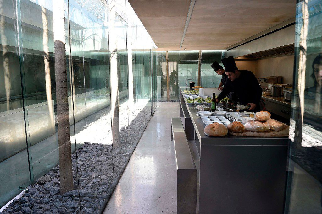 """A picture taken in Olot on March 2, 2017 shows chefs in the kitchen of the restaurant """"les Cols"""" designed by RCR architects, formed by Spanish architects, Rafael Aranda, Carme Pigem and Ramon Vialta."""