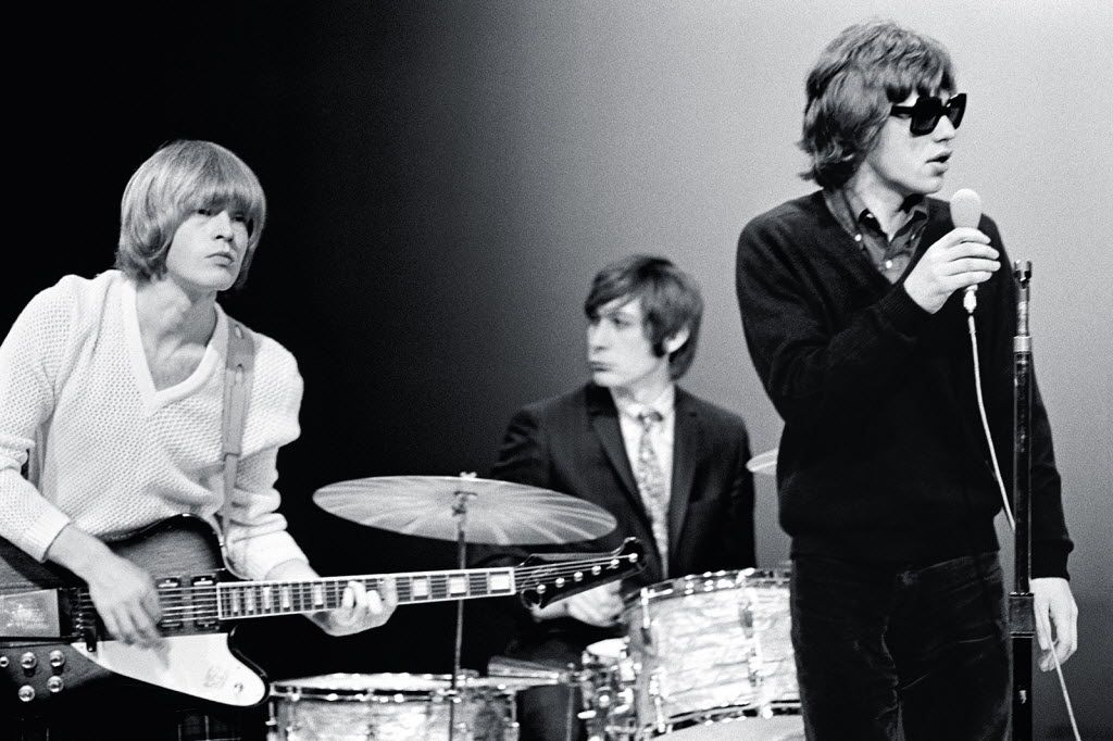 "This Nov. 11, 1965 photo supplied by the Rock and Roll Hall of Fame and Museum shows, from left, Brian Jones, Charlie Watts and Mick Jagger of The Rolling Stones on the NBC teen music show ""Hullabaloo,"" in New York."
