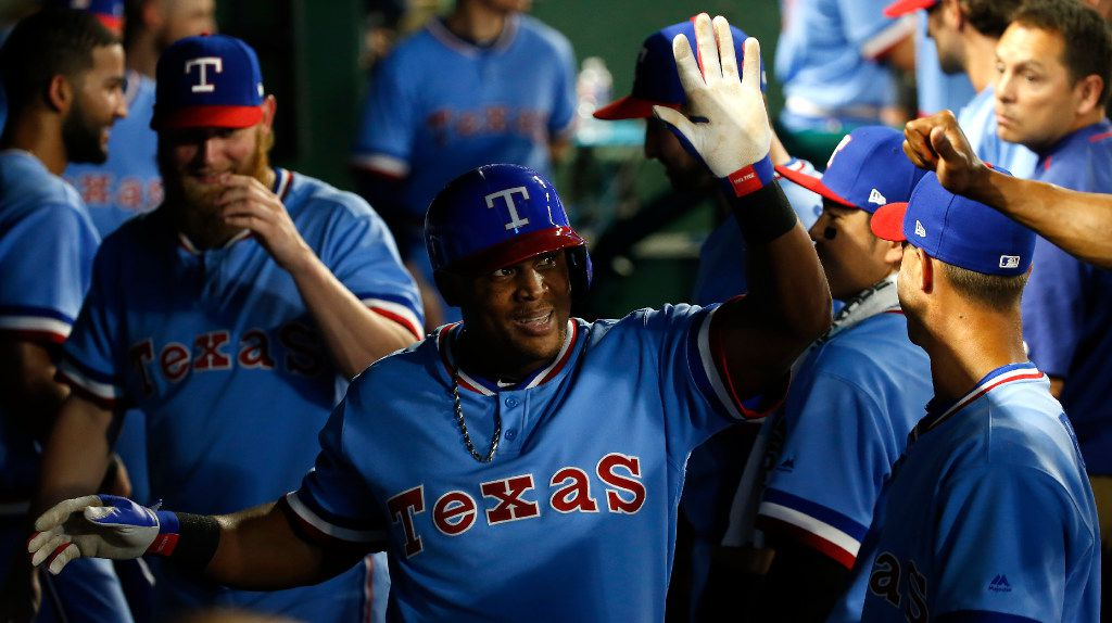 Texas Rangers third baseman Adrian Beltre (29) is congratulated by teammates for his two-run home run in the dugout during the third inning against Los Angeles Angels at Globe Life Park in Arlington, Texas, Saturday, July 8, 2017. (Jae S. Lee/The Dallas Morning News)