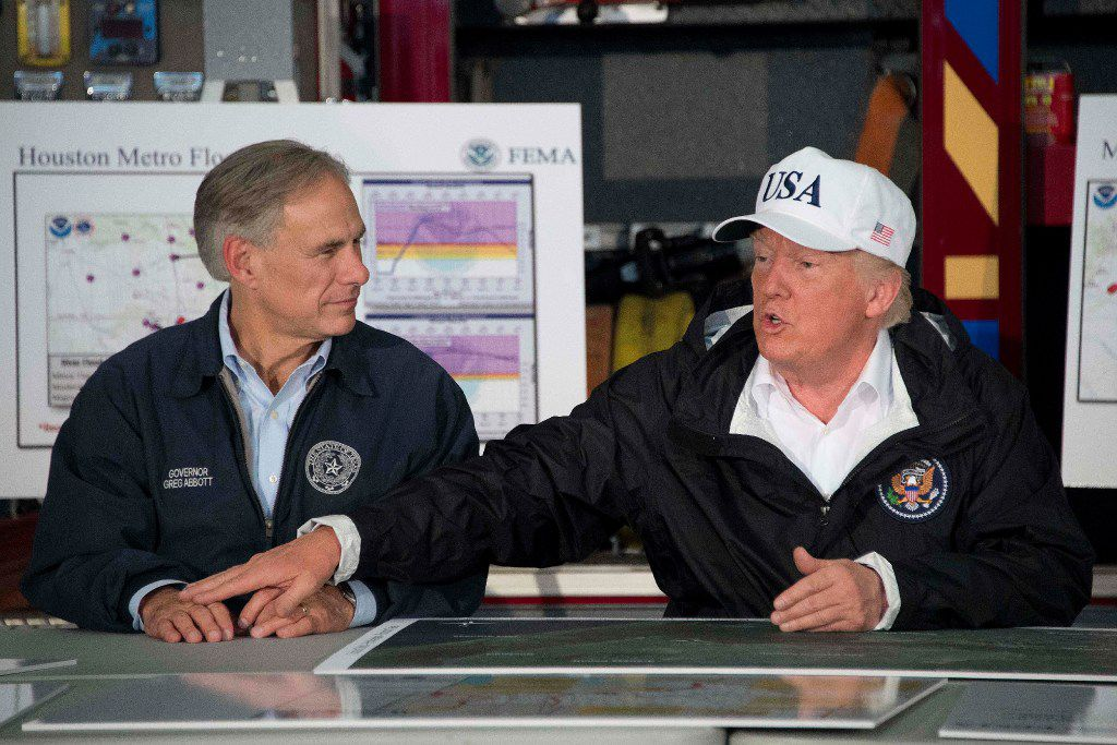 President Donald Trump sits with Texas Gov. Greg Abbott during a briefing in Corpus Christi.