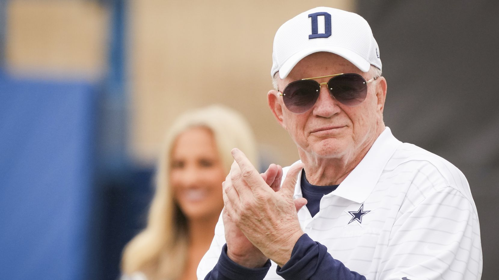 Owner and general manager Jerry Jones applauds a performance by the Dallas Cowboys cheerleaders during opening ceremonies before a practice at training camp on Saturday, July 24, 2021, in Oxnard, Calif.