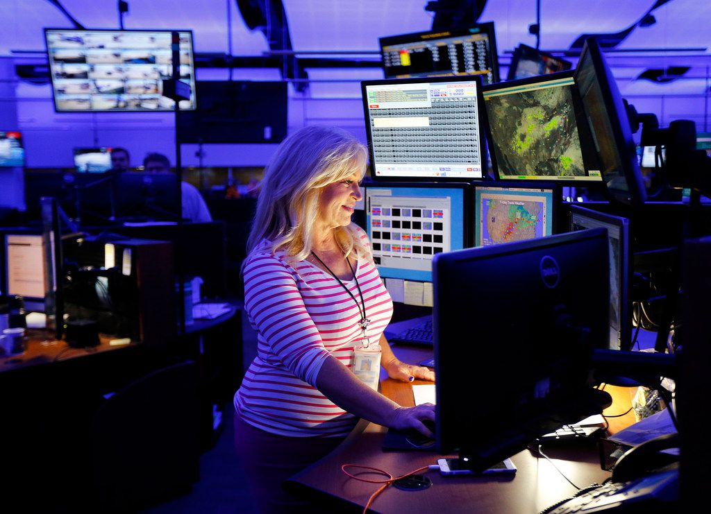 Meteorologist Rebecca Miller monitors the weather in Southwest Airlines NOC (Network Operations Control) so she can coordinate with flight operators in their Dallas facility near Love Field, Thursday, October 5 , 2017. Miller worked as a television meteorologist for years before joining Southwest. (Tom Fox/The Dallas Morning News)