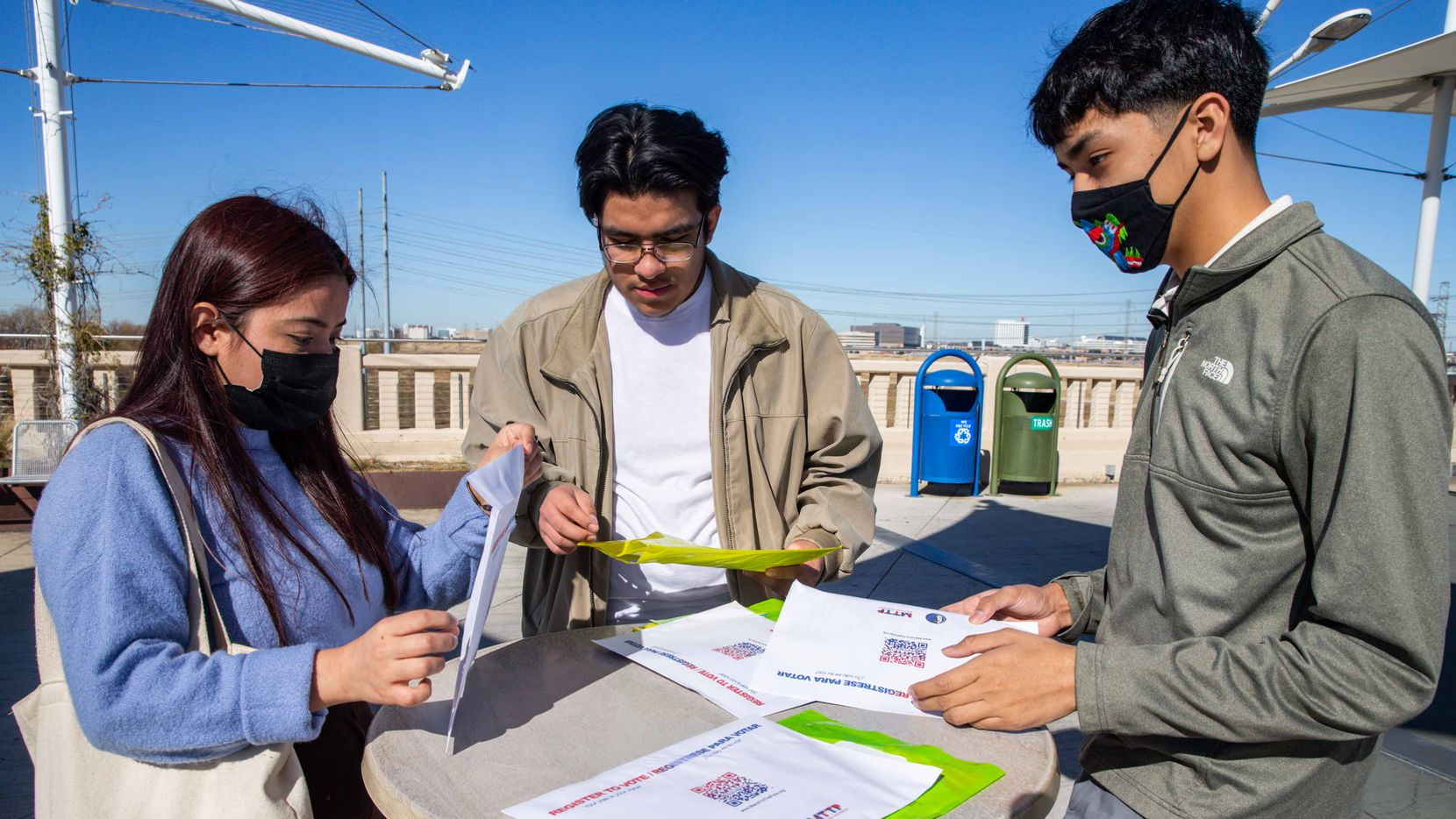 From left, high schoolers Daniela De La Cruz, Adrian Sanchez, and Angel Garcia Donjuan, show the pamphlets with information about the past presidential elections that they used to inform students through their student-run organization, SVEC. Going into 2021, they are keeping their peers excited about voting for local elections by keeping them informed and engaged in Dallas on Monday, December 21, 2020.