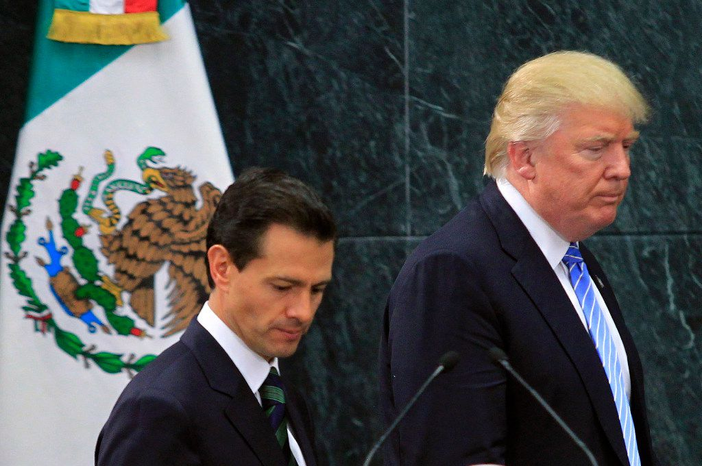 President Trump, right, with Mexican President Enrique Pena Nieto after their Aug. 31, 2016, meeting in Mexico City. Trump's executive order to immediately start construction of a border wall has widened his rift with Mexico. (Str/Xinhua/Sipa USA/TNS)