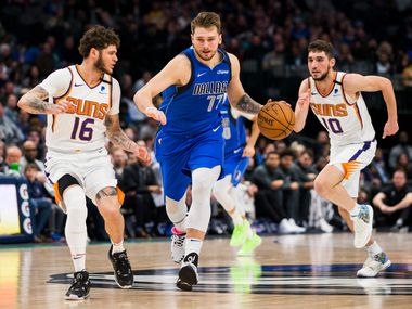 Dallas Mavericks guard Luka Doncic (77) gains control of a loose ball during the fourth quarter of an NBA game between the Dallas Mavericks and the Phoenix Suns on Tuesday, January 28, 2020 at the American Airlines Center in Dallas.