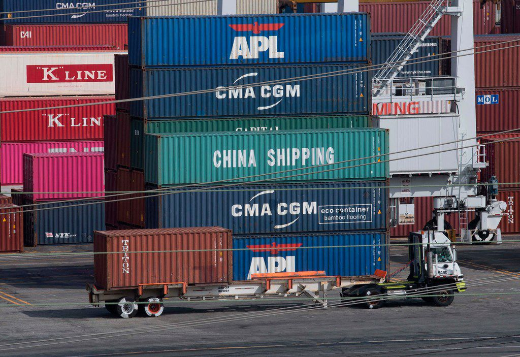 A truck passed by shipping containers at the Port of Los Angeles on Sept. 1, after new tariffs on Chinese imports were imposed by President Donald Trump,.