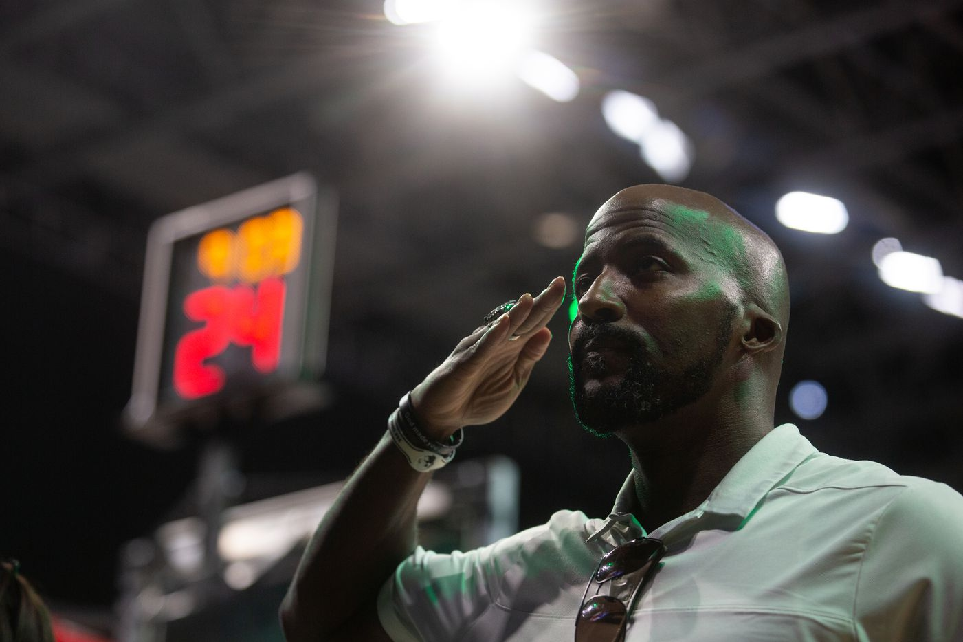 Mikel Ray, a veteran of the U.S. Navy who served 5 and a half years, salutes the flag during the Star-Spangled Banner before the Dallas Wings game against New York Liberty at College Park Center in Arlington, TX on September 11, 2021.  (Shelby Tauber/Special Contributor)
