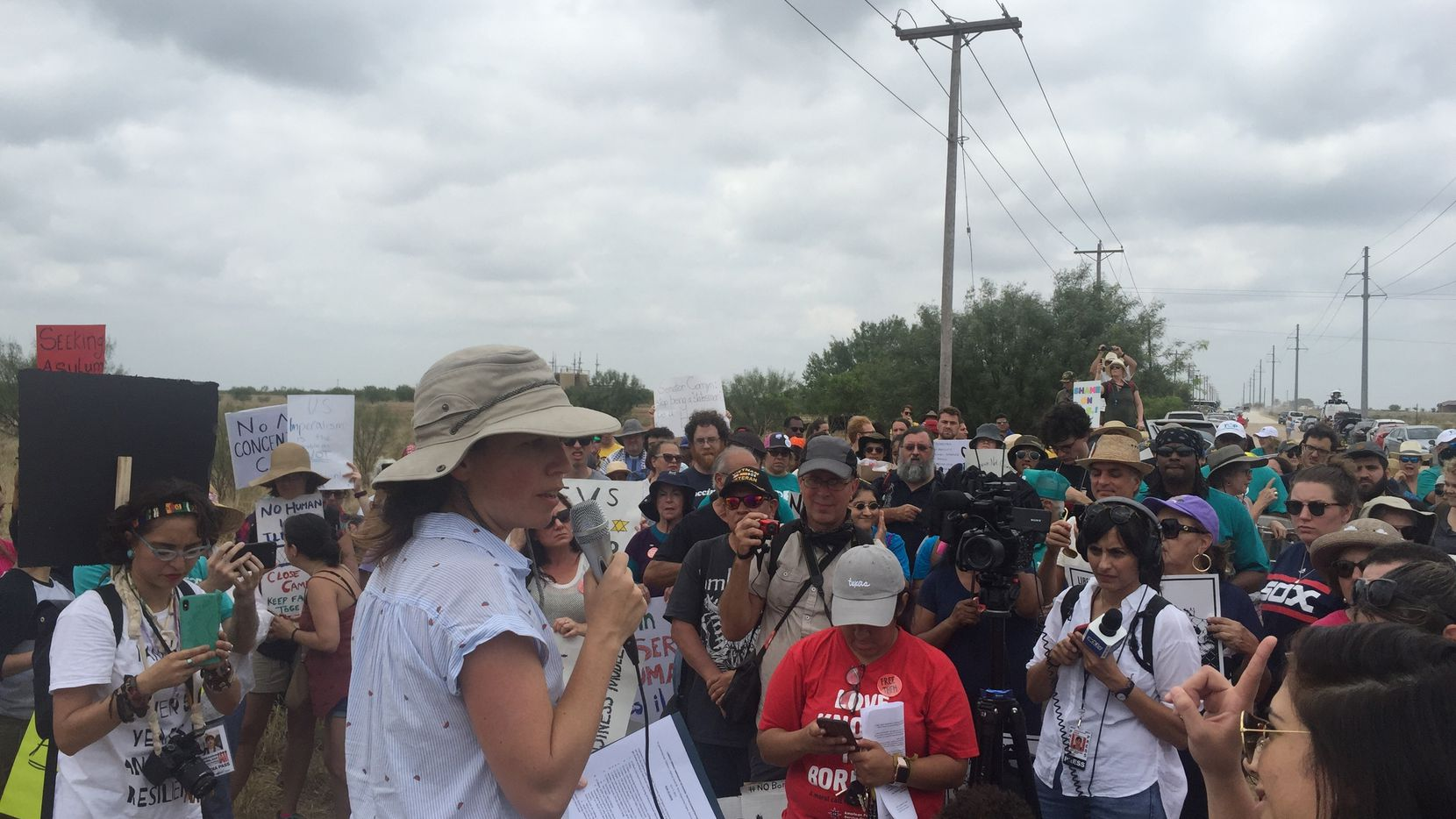 Cheasty Anderson, senior policy director for Children's Defense Fund Texas and one of the organizers of the protest, spoke as activists gathered to call for an end to migrant child detention in Carrizo Springs, Texas.