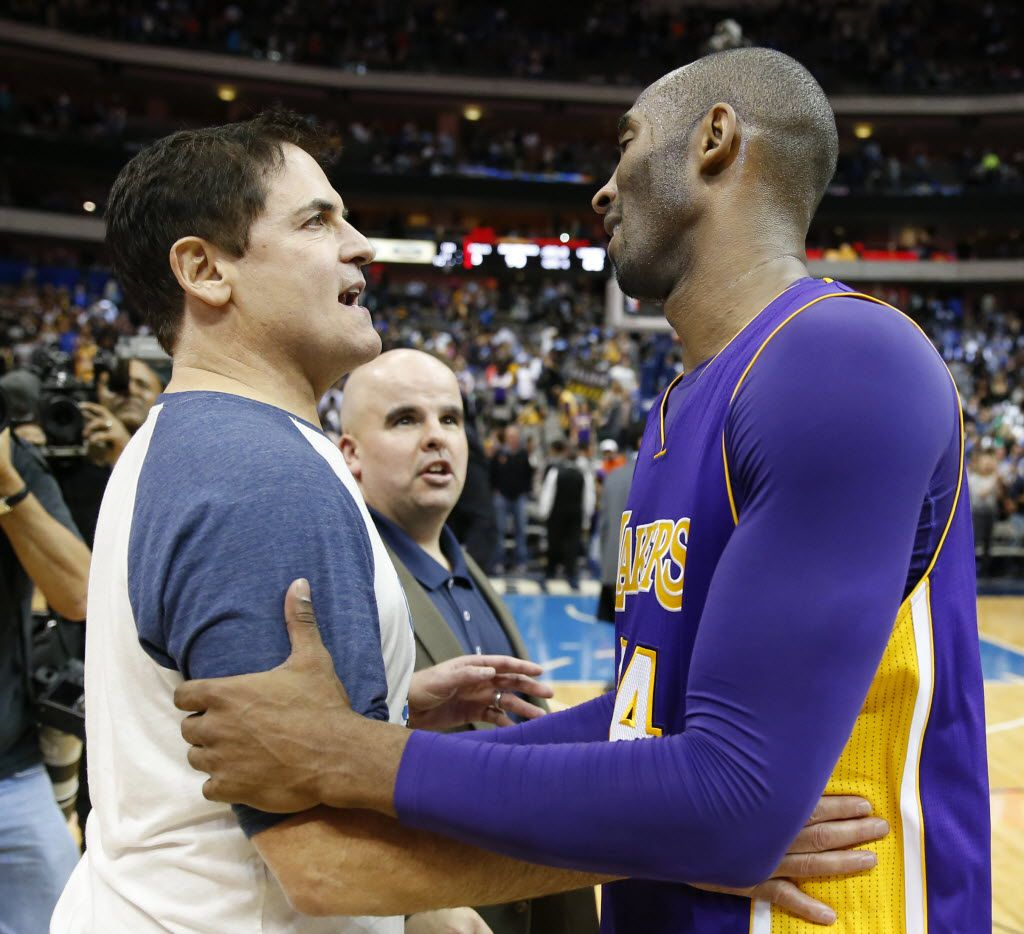 Dallas Mavericks owner Mark Cuban talks with Los Angeles Lakers forward Kobe Bryant (24) after the game at American Airlines Center in Dallas on Friday, November 13, 2015. Dallas Mavericks defeated the 90-82.