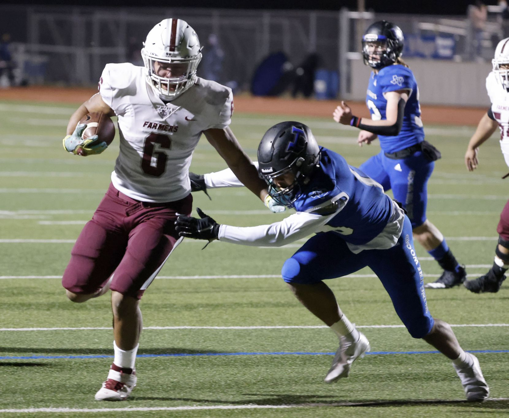 Lewisville running back Damien Martinez (6)  scores a touchdown as Hebron's Vincon Miller (13) attempts a tackle during their District 6-6A high school football game on Dec. 4, 2020. (Michael Ainsworth/Special Contributor)