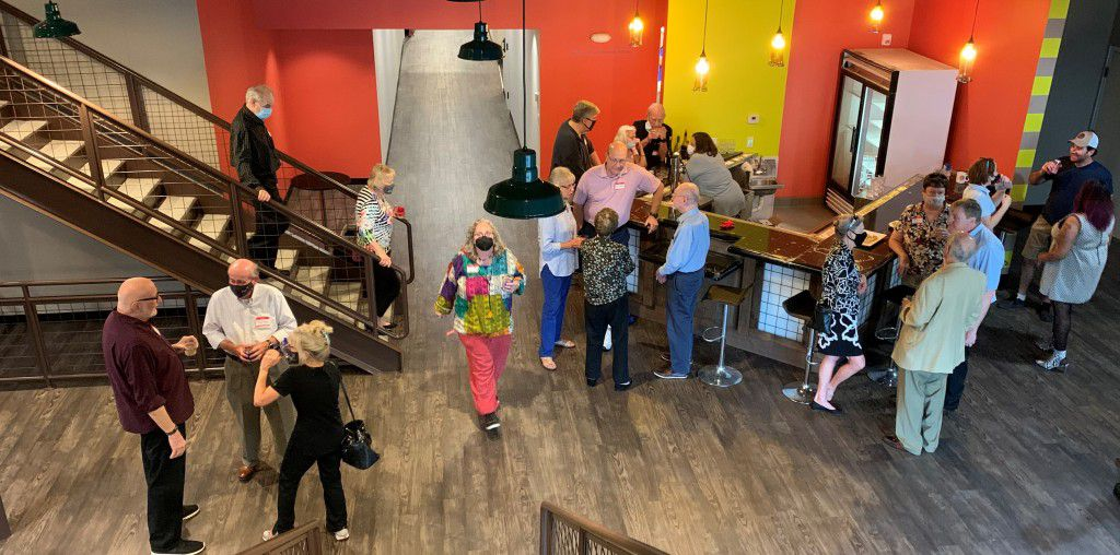 Stage West's newly renovated lobby has an upgraded bar and kitchen. It also has a new balcony space. Former Stage West artistic director Jim Covault is at far left.