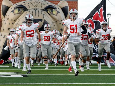The Lovejoy Leopards enter the field to face Prosper Rock Hill in a District 7-5A high school football game played at the Children's Health Stadium on Friday, Oct. 1, 2021, in Prosper. (Steve Nurenberg/Special Contributor)