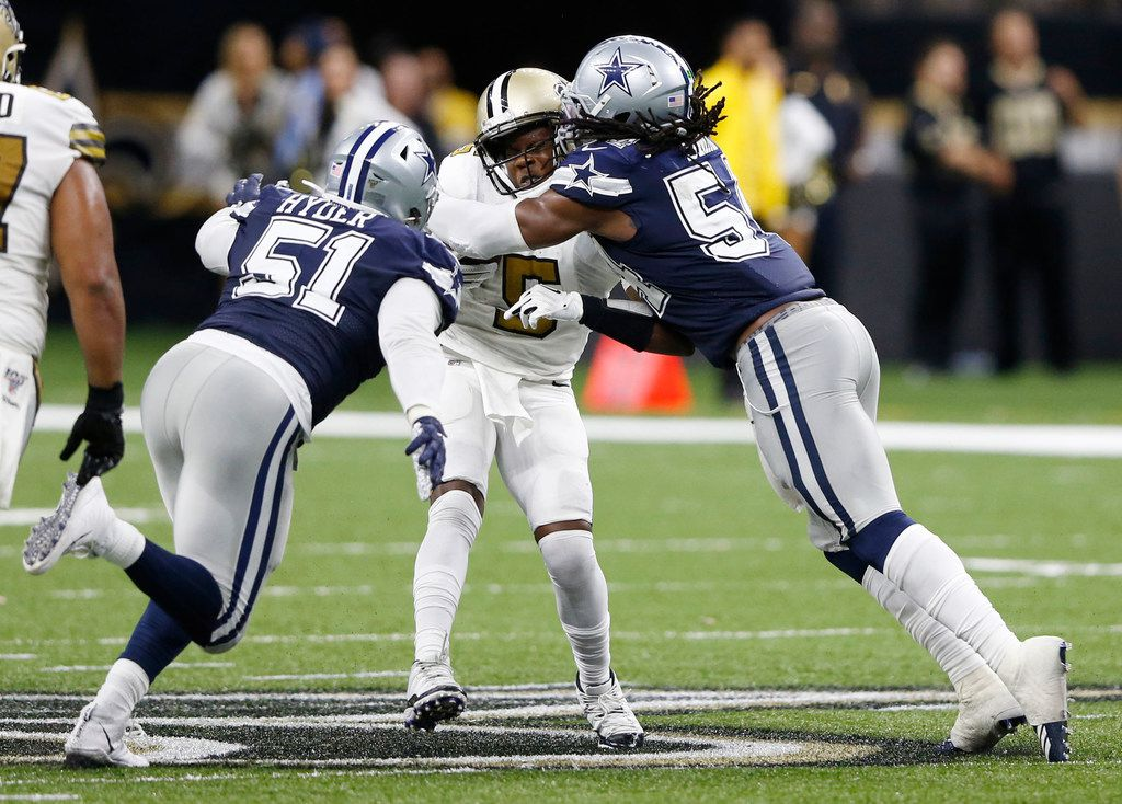 Dallas Cowboys middle linebacker Jaylon Smith (54) sacks New Orleans Saints quarterback Teddy Bridgewater (5) on a third down play as Dallas Cowboys defensive end Kerry Hyder (51) closes in on the play during the second half of play at the Superdome in New Orleans, Louisiana on Sunday, September 29, 2019. New Orleans Saints defeated Dallas Cowboys 12-10.
