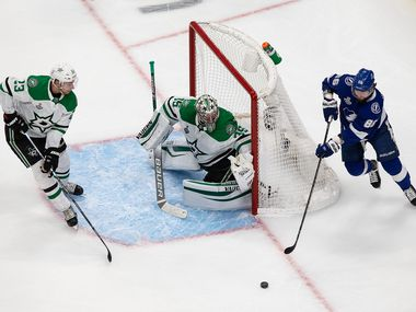 Esa Lindell (23) and goaltender Anton Khudobin (35) of the Dallas Stars defend against Nikita Kucherov (86) of the Tampa Bay Lightning during Game Two of the Stanley Cup Final at Rogers Place in Edmonton, Alberta, Canada on Monday, September 21, 2020.