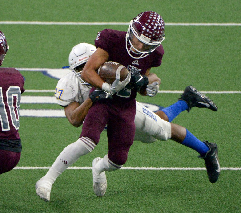Ennis' Dyllan Santos (2) runs through a tackle attempt by Frisco's Aaron Taylor (27) in the second half during a Class 5A Division II Region  II semifinal high school football game between Frisco and Ennis, Friday, Nov. 29, 2019, in Frisco, Texas. Ennis won 17-0. (Matt Strasen/Special Contributor)
