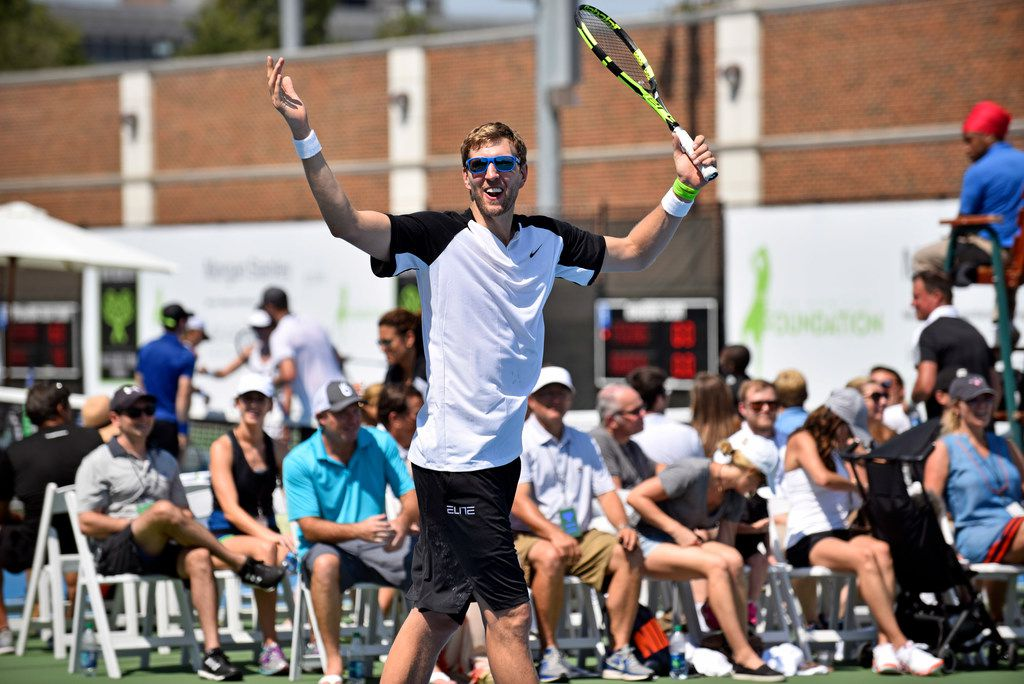 Dallas Mavericks power forward Dirk Nowitzki reacts during a tennis match at the 2nd annual Dirk Nowitzki Pro Celebrity Tennis Classic at the SMU Tennis Center in Dallas, Saturday, Sept. 16, 2017.