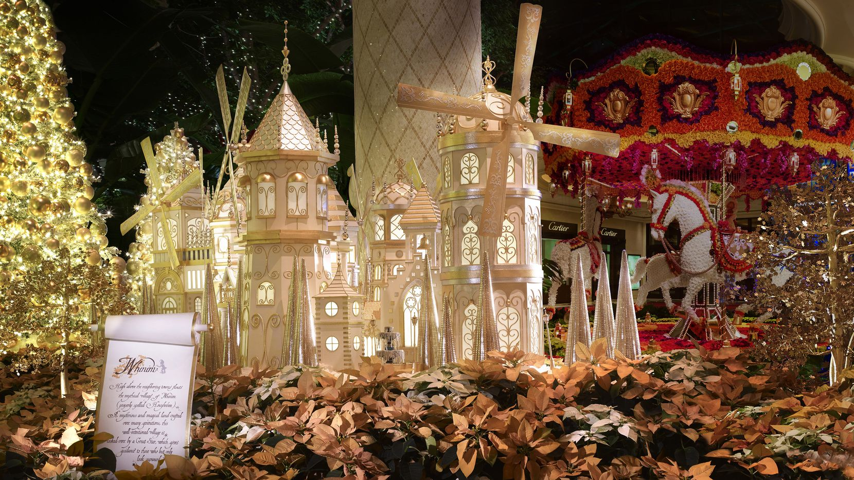 "Wynn Las Vegas' atrium has been reimagined for the holiday season as a snow-covered village plucked out of ""Gulliver's Travels."""