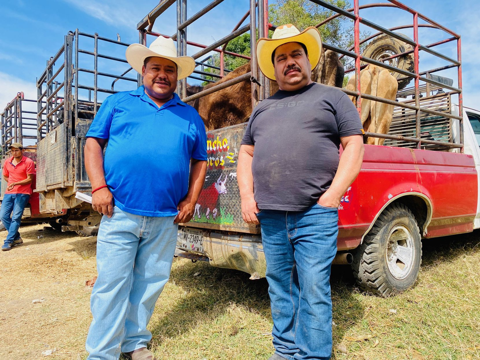 Joaquin Garcia Lopez, left, and his brother Eliel reunite at an outdoor livestock market in Zitacuaro, Michoacan, Mexico, on March 6, 2020. Joaquin had just flown in from Seattle and told his brother coronavirus should be taken seriously.