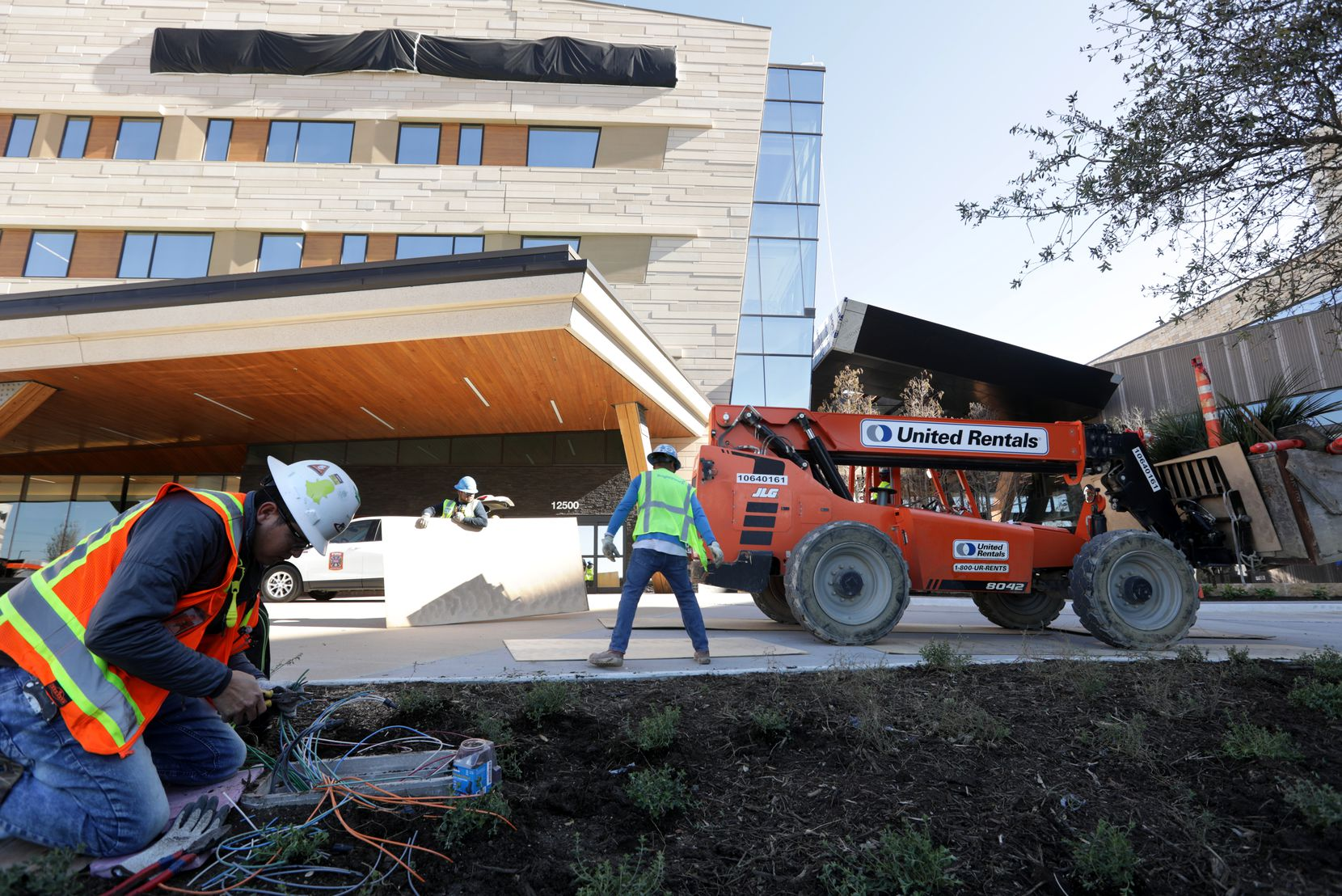 Crews complete exterior work at Texas Health Frisco, set to open this month. The campus includes a 325,000-square-foot hospital, a 125,000-square-foot medical office building and a 90,000-square-foot specialty clinic.