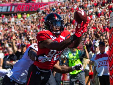 LUBBOCK, TEXAS - OCTOBER 05: Wide receiver KeSean Carter #82 of the Texas Tech Red Raiders catches a touchdown pass during the first half of the college football game between the Texas Tech Red Raiders and the Oklahoma State Cowboys on October 05, 2019 at Jones AT&T Stadium in Lubbock, Texas.