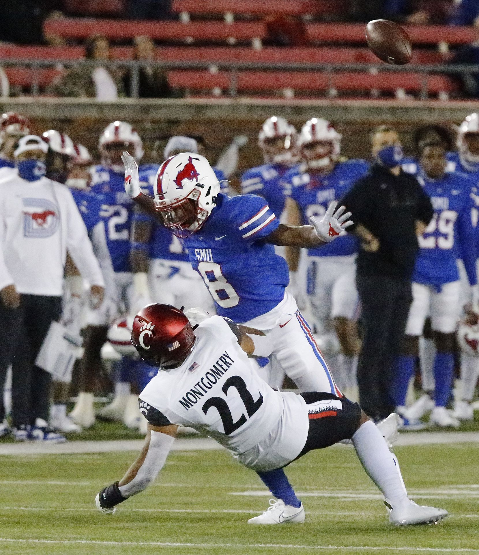 Southern Methodist Mustangs cornerback Bryan Massey (8) runs into Cincinnati Bearcats punt returner Ryan Montgomery (22) during the first half as SMU hosted Cincinati University in an AAC football game at Ford Stadium in Dallas on Saturday night, October 24, 2020. (Stewart F. House/Special Contributor)