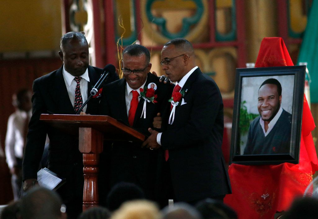 Bertrum Jean father of Botham Shem Jean is consoled at the pulpit during the funeral of his son at Minor Basilica of the Immaculate Conception in Castries, St. Lucia on Monday, September 24, 2018. Jean was shot and killed in his apartment by off duty Dallas police officer Amber Guyger. (Vernon Bryant/The Dallas Morning News)