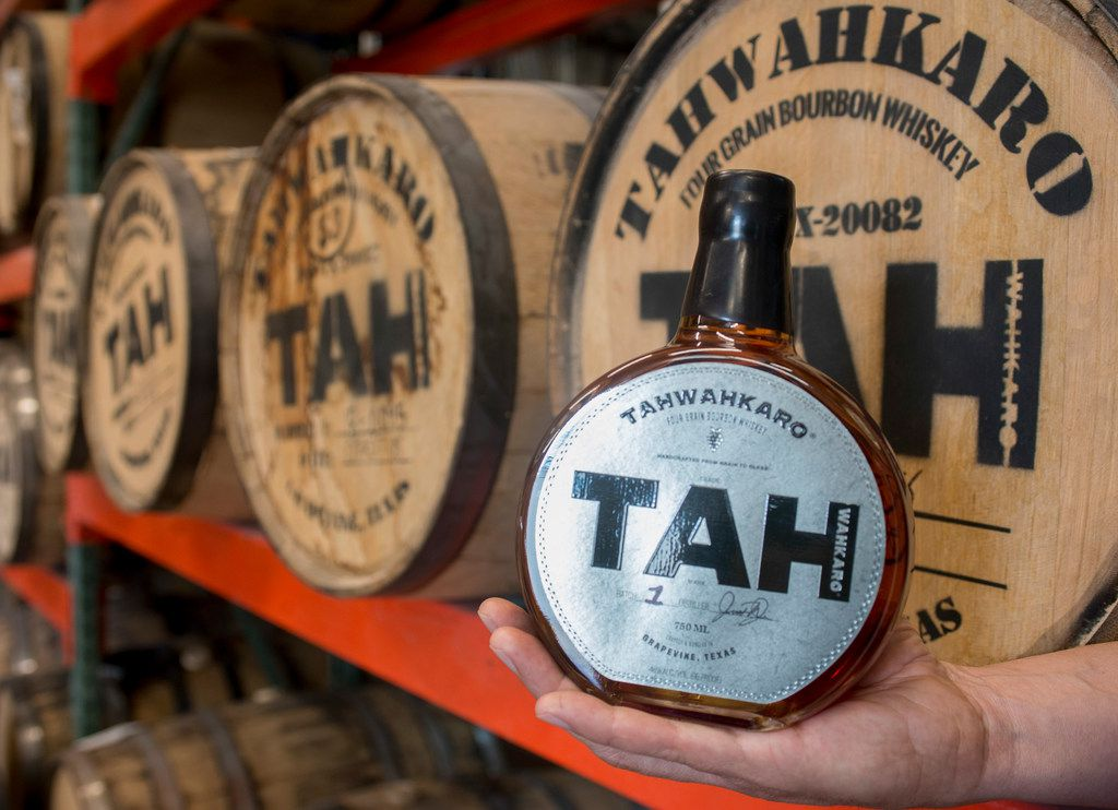 Chris Vivion holds a first-batch bottle of Tahwahkaro four-grain bourbon whiskey at the company's distillery in Grapevine, Texas on June 7, 2019.