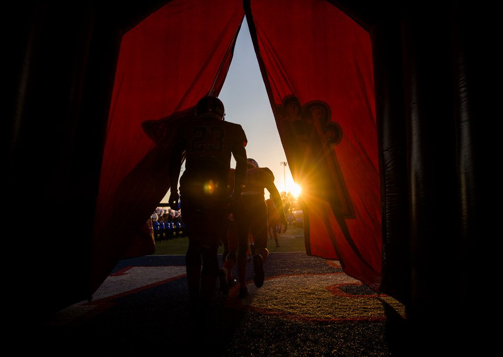 Duncanville football players enter the field through an inflatable tunnel before a high school football game between Lancaster and Duncanville on Friday, August 31, 2018 at Panther Stadium in Duncanville, Texas.
