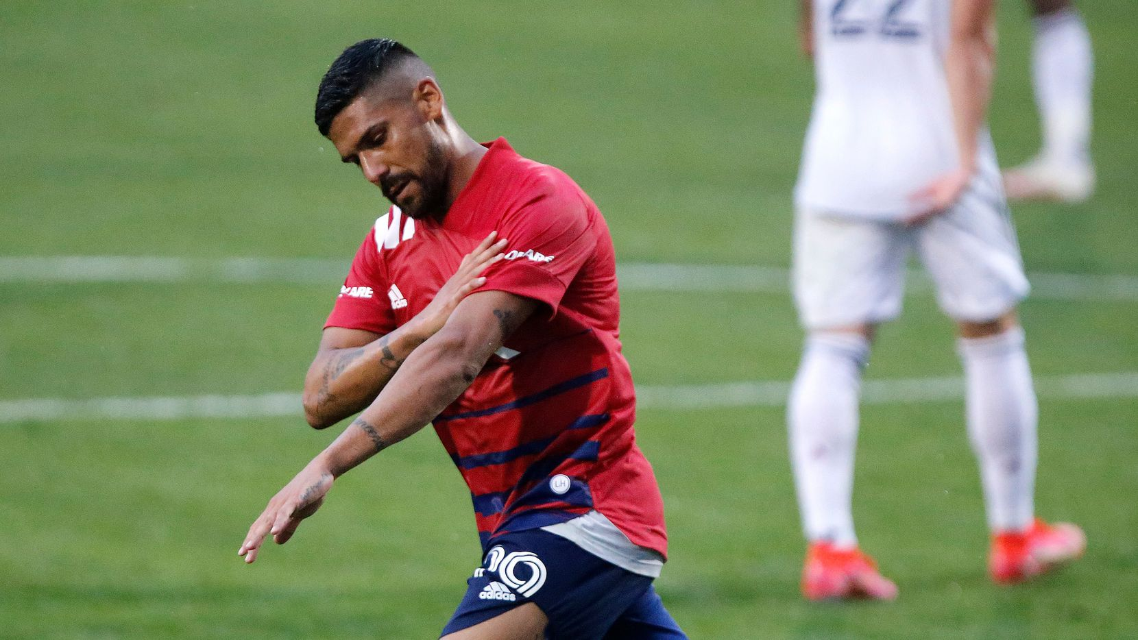 FC Dallas forward Franco Jara (29) brushes himself off after scoring a goal on a penalty kick to tie the game during the first half as FC Dallas hosted Real Salt Lake at Toyota Stadium in Frisco on Saturday, May 22, 2021. (Stewart F. House/Special Contributor)