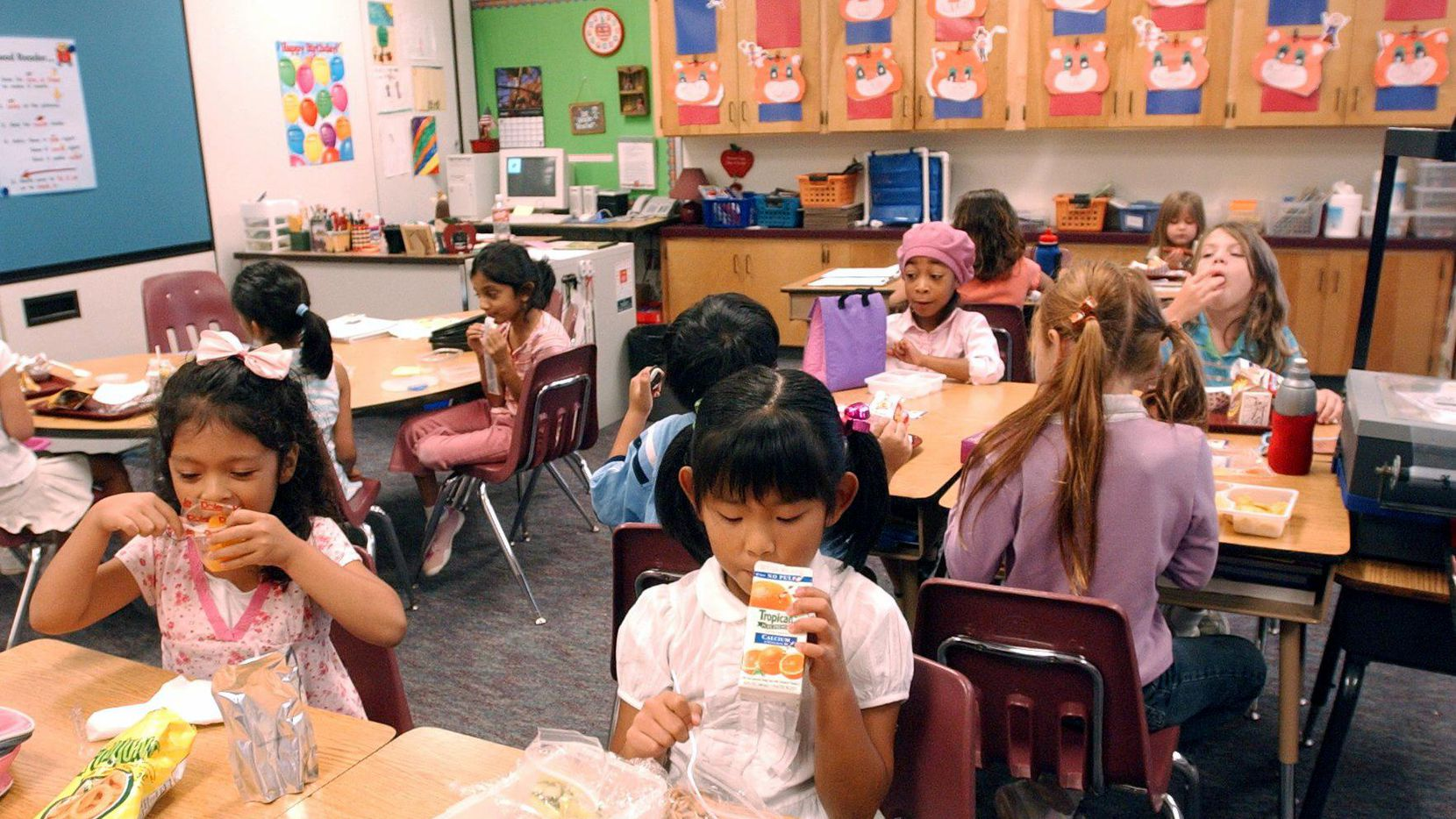 In this file photo, students eat lunch in a Plano ISD classroom.