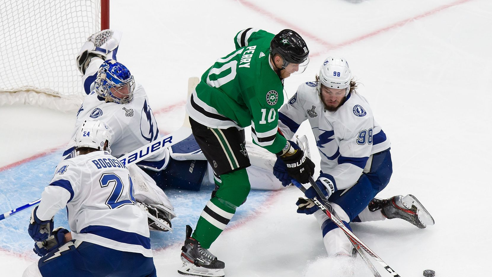Corey Perry (10) of the Dallas Stars battles against goaltender Andrei Vasilevskiy (88) and Mikhail Sergachev (98) of the Tampa Bay Lightning during Game Six of the Stanley Cup Final at Rogers Place in Edmonton, Alberta, Canada on Monday, September 28, 2020.