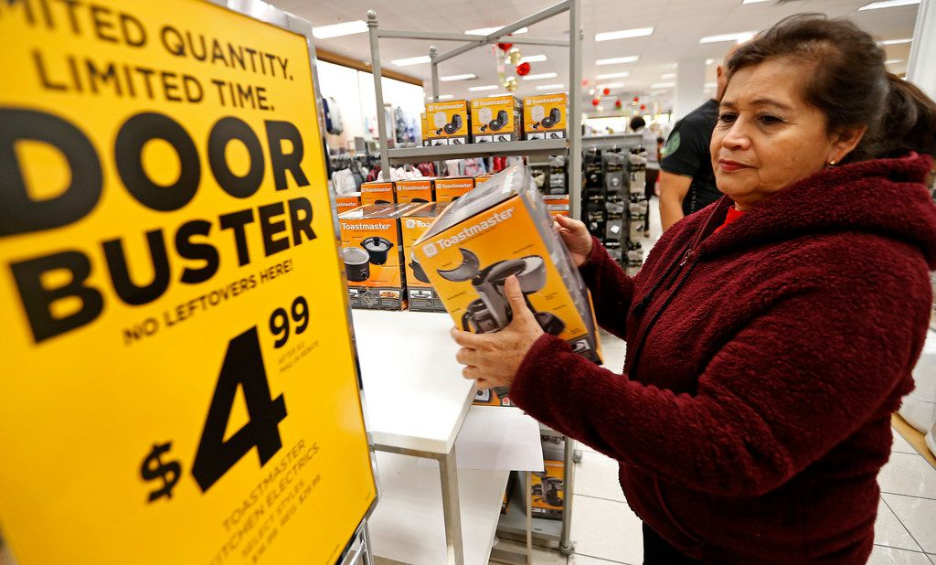 Shopper Daisy Ventura picks up a coffee maker at an early Black Friday sale in Dallas last year..