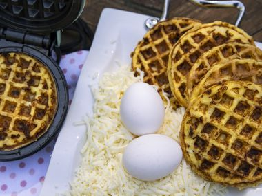 Basic chaffles, cooked in a mini waffle maker, are made solely with eggs and cheese.