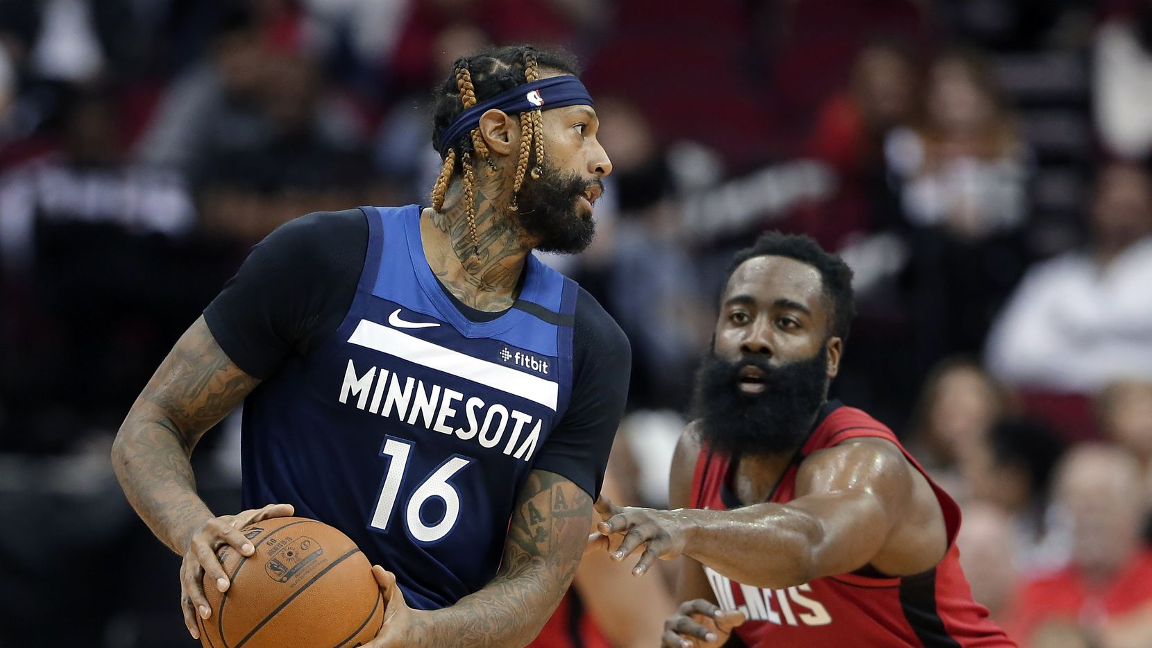 Minnesota Timberwolves forward James Johnson (16) looks to pass the ball while under pressure from Houston Rockets guard James Harden (13) during the second half of an NBA basketball game Tuesday, March 10, 2020, in Houston. (AP Photo/Michael Wyke)