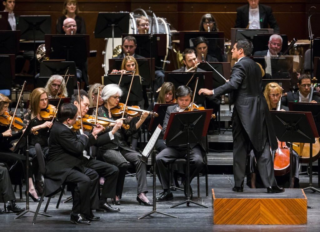 Music director Miguel Harth-Bedoya, right, conducts the Fort Worth Symphony Orchestra on Saturday, February 6, 2016 at Bass Performance Hall in Fort Worth.  (Ashley Landis/The Dallas Morning News)