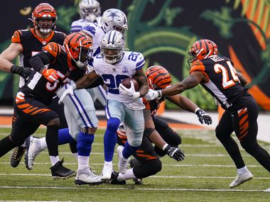 Dallas Cowboys running back Tony Pollard (20) runs against the Cincinnati Bengals in the second half of an NFL football game in Cincinnati, Sunday, Dec. 13, 2020. (AP Photo/Bryan Woolston)