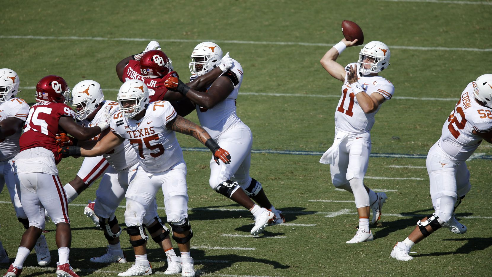 Texas Longhorns quarterback Sam Ehlinger (11) throws a first quarter pass against the Oklahoma Sooners in the Red River Rivalry at the Cotton Bowl in Dallas, Saturday, October 10, 2020.