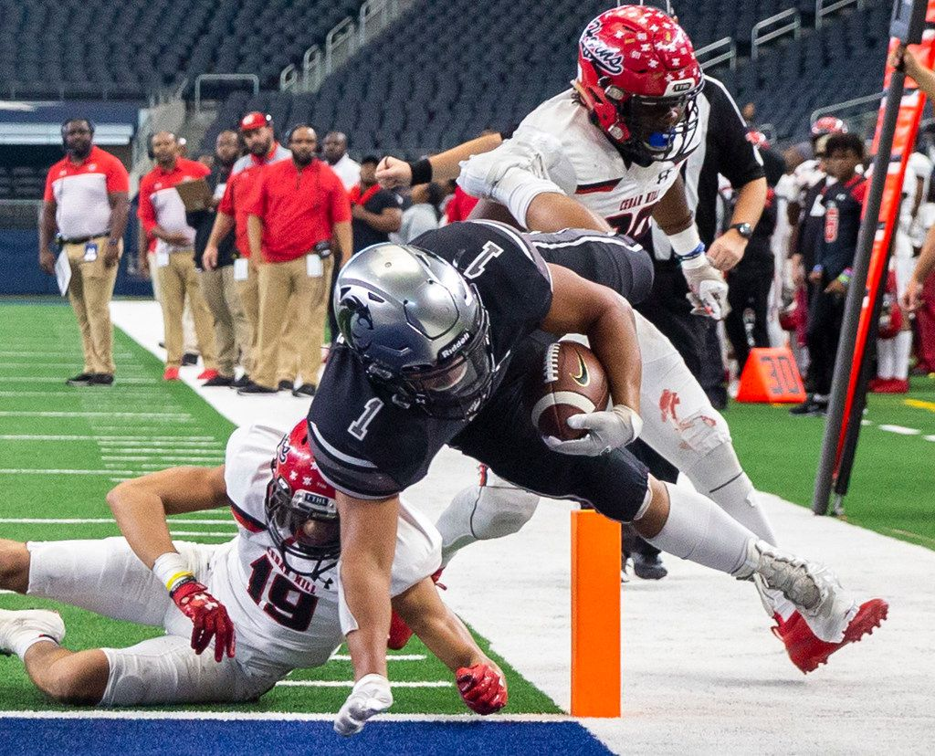 Denton Guyer running back Kaedric Cobbs (1) barely crosses into the end zone during the final quarter of a Class 6A Division II area-round high school football playoff game at the AT&T Stadium in Arlington, Texas, on Saturday, November 23, 2019.  Denton Guyer beat Cedar Hill 50-41 in a major comeback after trailing by 27 points at halftime. (Lynda M. Gonzalez/The Dallas Morning News)